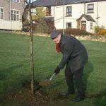 Grahame Morris with shovel full of dirt