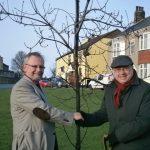 Grahame Morris shaking hands at tree planting